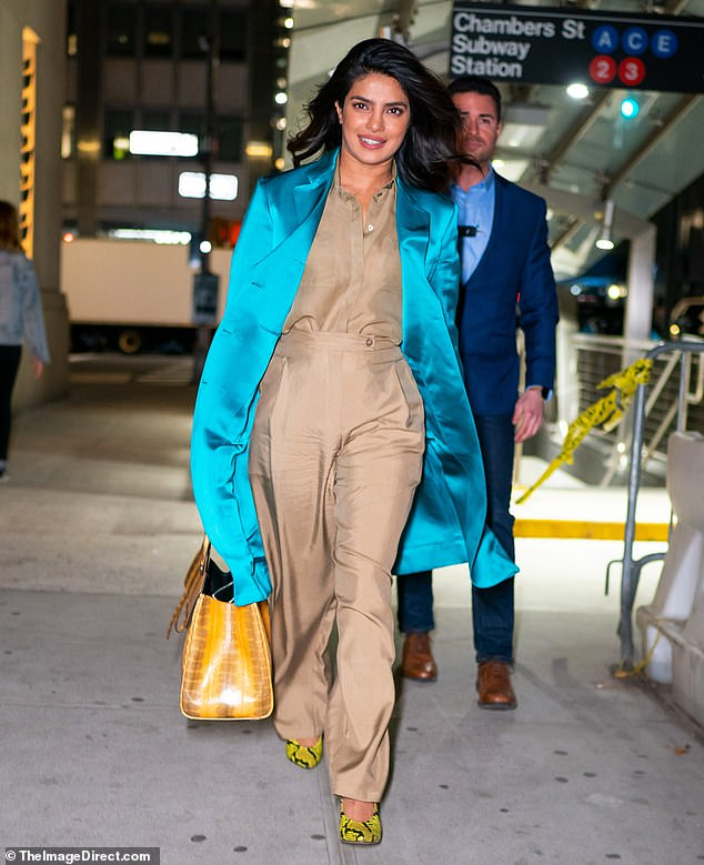 Priyanka Chopra pairs taupe hued blouse and trousers with teal duster coat as she steps out in NYC